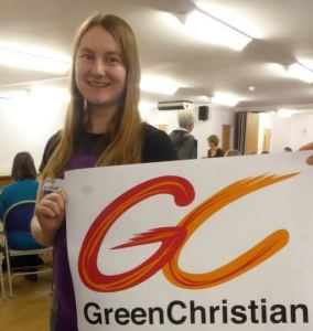 Amy at the Annual Member's Meeting holding our new logo