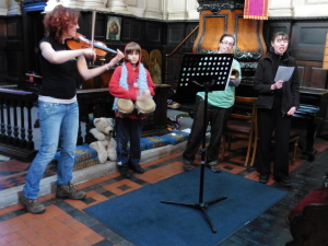 Ruth, Emma, Rebecca and Tom leading the Iona songs